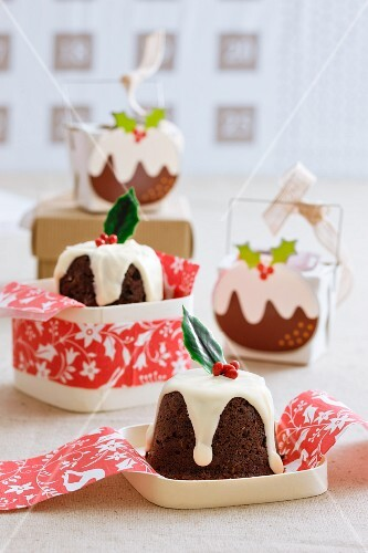 Mini Christmas puddings with white icing