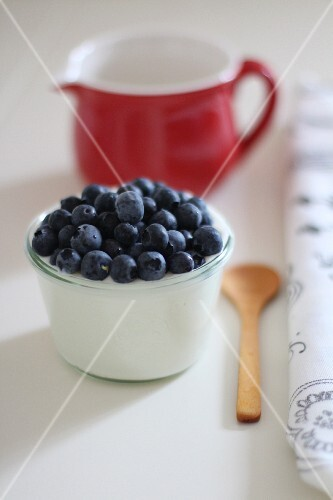 Yoghurt with fresh blueberries in a glass
