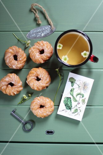 Glazed, deep-fried pastry rings with a cup of tea