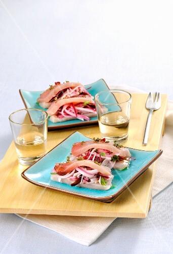 Crudo di pesce spada (raw swordfish with salad and bacon, Italy)