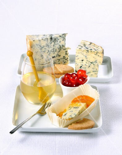 Blue cheese with various jams, savoury biscuits and candied fruit