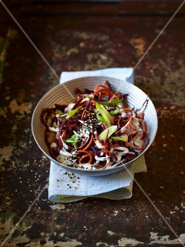Carrot spaghetti with spring onions and sesame seeds