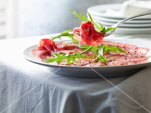 Beef carpaccio with pepper and rocket