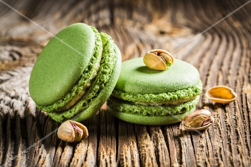 Green pistachio macaroons on a wooden table