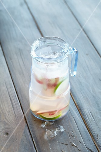 Ginger and rhubarb water with ice cubes