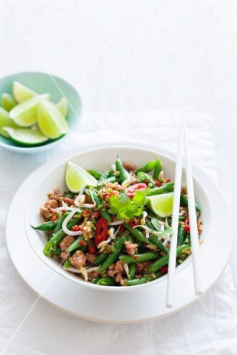 Fried beans with minced meat and limes (Asia)