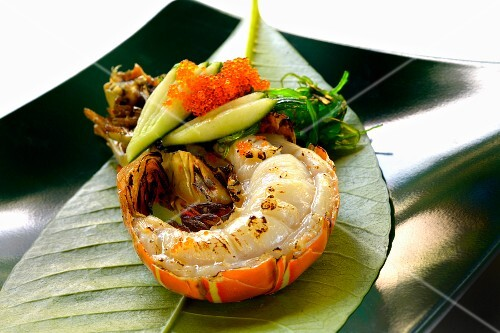 Grilled lobster tail on a banana leaf (Asia)