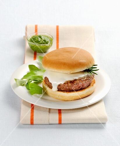 A hamburger with scamorza and basil pesto