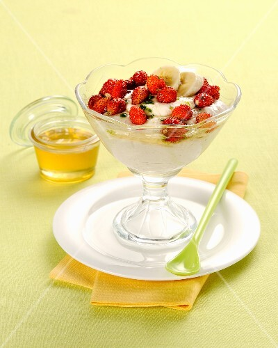 Banana mousse with fresh wild strawberries