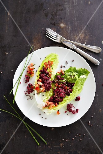 Chopped beetroot served on lettuce leaves