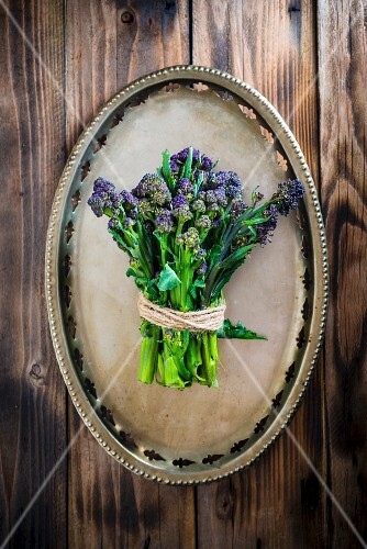 Purple sprouting broccoli on a metal plate