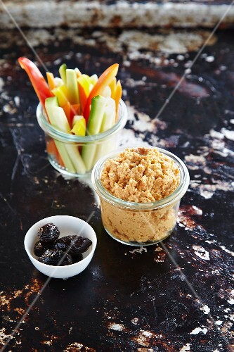 Pepper hummus in a glass served with julienned vegetables to dip