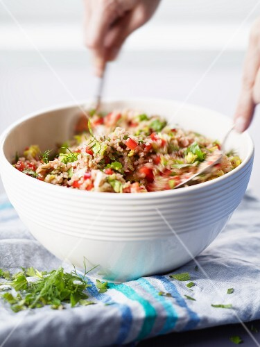 Bulgur with peppers, pomegranate seeds and fresh herbs