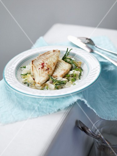 Halibut on a bed of chicory with blanched samphire