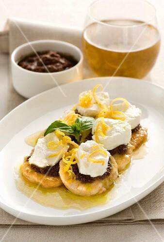 Mini chicken escalopes with olive cream, ricotta and lemon zest