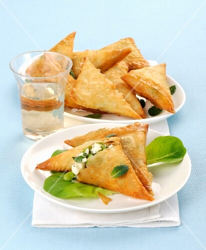 Filo pastry triangles filled with feta cheese and broad beans