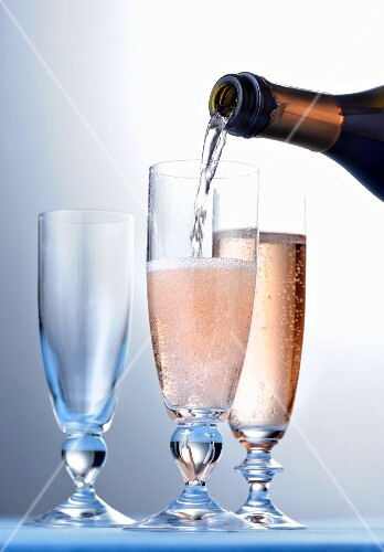 Rosé champagne being poured