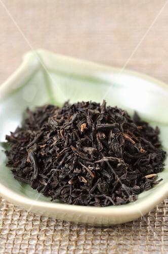Black tea in a leaf-shaped dish