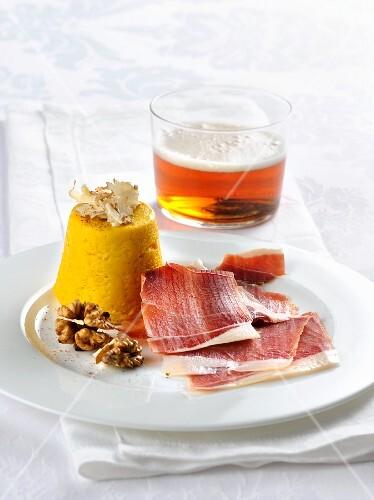 Truffled pumpkin flan with smoked ham and walnuts