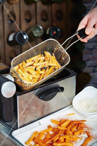Sweet potato chips being made in a fryer