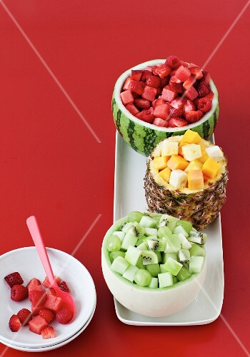 Various fruit salads served in hollowed out fruit shells