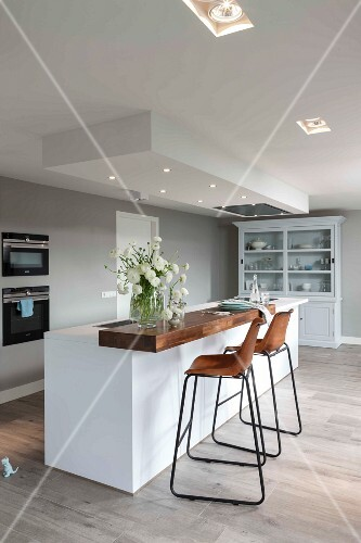A Modern Kitchen In White With Built In Spot Lights In A