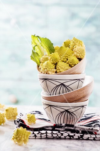 Romanesco broccoli florets in a stack of bowls