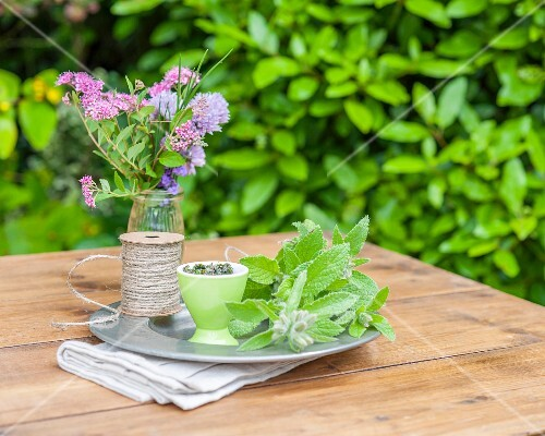 Borage and a bunch of flowers on a garden table