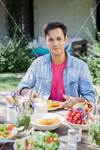 A man enjoying a meal outdoors