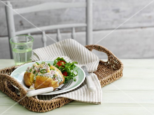 A jacket potato field with creamy chicken and pineapple