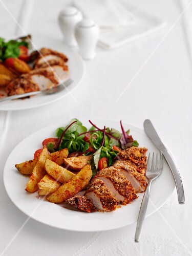 Breaded Maryland chicken with potato wedges and salad