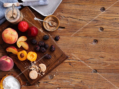 Fruit, sugar, biscuits and cream as ingredients for desserts