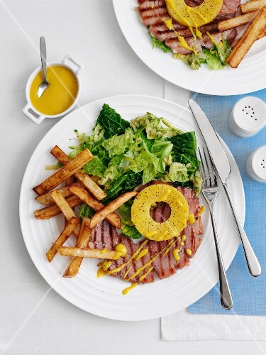 Gammon steak with pineapple, chips and salad