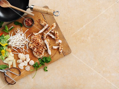 Grilled chicken, vegetables and spices as ingredients for chicken stir-fry