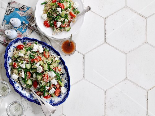 Bulgur and quinoa salad with herbs, vegetables and feta cheese