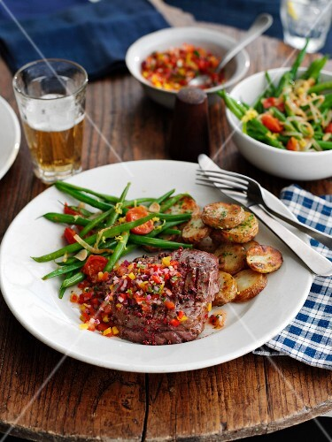 Beef steak with pepper salsa, green beans and fried potatoes