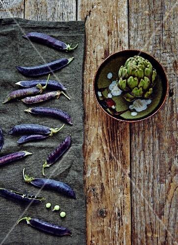 Purple pea pods and an artichoke