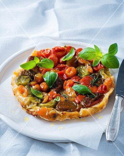 Tarte tatin with heirloom tomatoes and basil