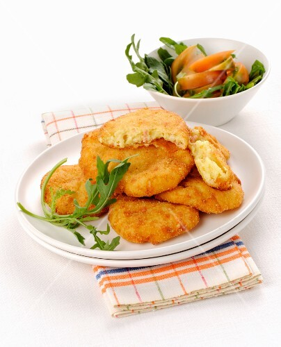 Potato fritters with salad
