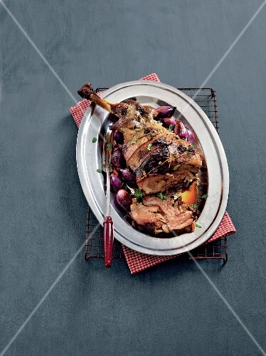 Oven-roasted shoulder of lamb with onions and herbs
