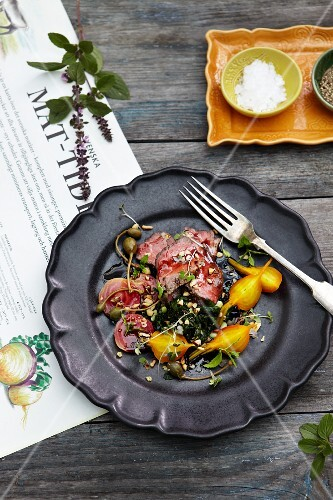 Beef with red and yellow beetroot, capers and herbs