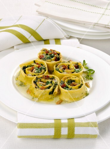 Gratinated pasta rolls with fresh herbs and pine nuts