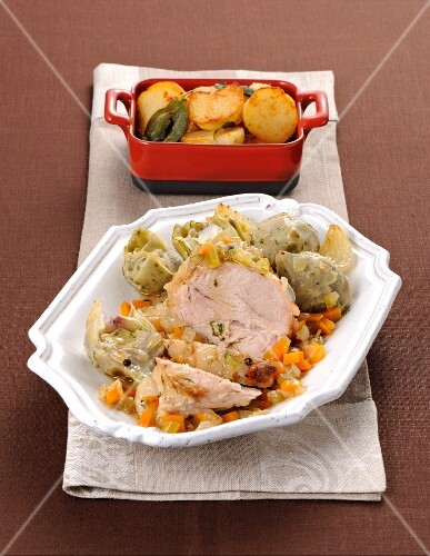 Braised pork with artichokes and roast potatoes