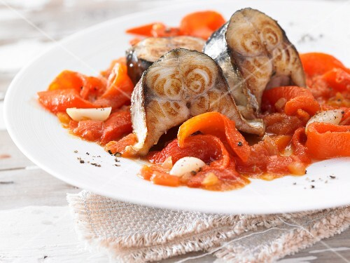 Braised mackerel on a red pepper medley