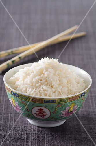 Cooked rice in a porcelain bowl