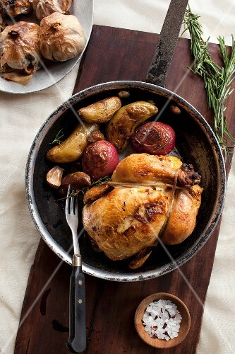 Roast chicken and vegetables in a pot