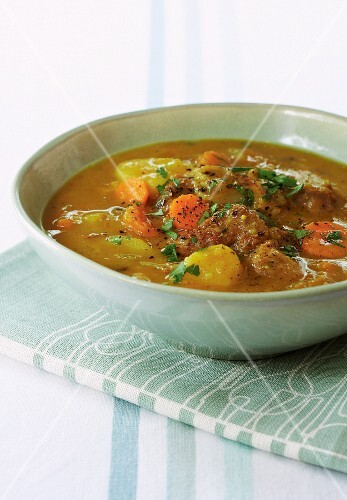 Potato and curry soup with lamb
