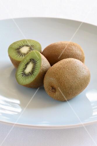 Kiwi fruit, whole and halved