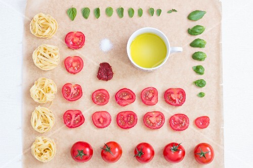Tagliatelle and ingredients in neat rows