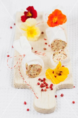 Homemade butter rolls with nasturtiums and pink peppercorns